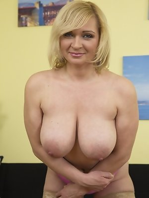 Naughty housewife with firm tits playing alone